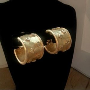 Vintage Givenchy goldtone G wide clip-on ears EVC